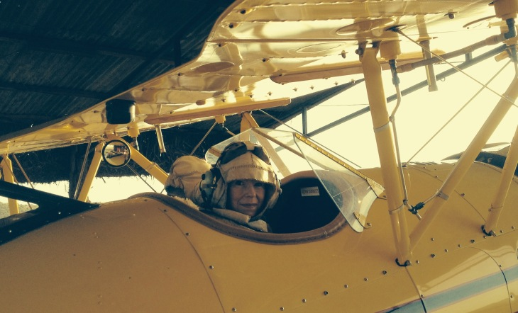 Paula McLain gets into Beryl Markham's frame of mind (and into a bi-plane -- the Gypsy Moth, which was used in the filming of Out of Africa). Photo by Liz Wheeler.
