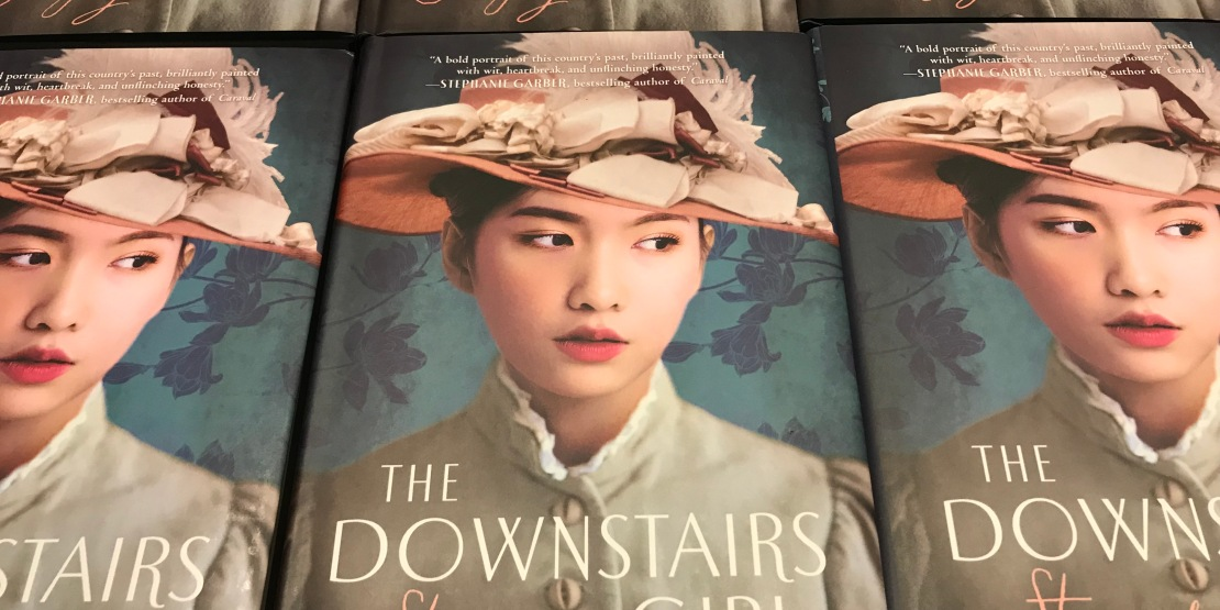 Copies of the novel The Downstairs Girl by Stacey Lee